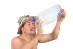 Young man looking into empty bottle Stock Images