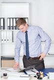 Young man is looking into a file in the office Stock Image