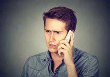 Man reacting on phone talk stock photography
