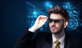 Young man looking with futuristic smart high tech glasses. Concept Stock Photo