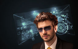 Young man looking with futuristic smart high tech glasses Royalty Free Stock Images
