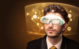 Young man looking at futuristic social network map Stock Photography