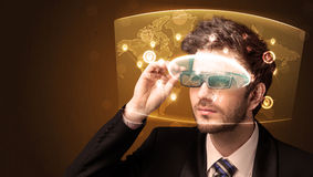 Young man looking at futuristic social network map Royalty Free Stock Photo
