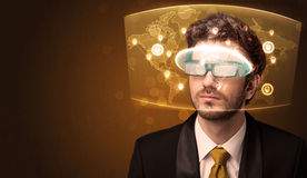 Young man looking at futuristic social network map Royalty Free Stock Images