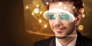 Young man looking at futuristic social network map Stock Image