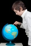 Young man looking at the globe Royalty Free Stock Photos