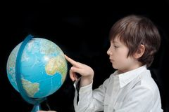 Young man looking at the globe Stock Images