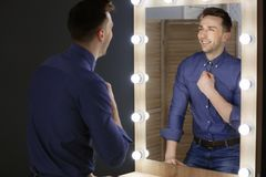 Young man looking at himself Royalty Free Stock Images