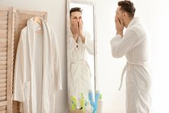 Young man looking at himself in mirror Royalty Free Stock Photo