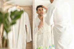 Young man looking at himself in mirror Stock Image