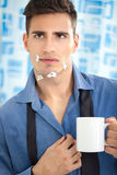 Young man looking his injury face in mirror Stock Images