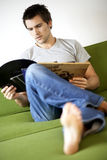 Young man looking at his record collection Royalty Free Stock Photos