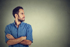 Young man looking at his side Royalty Free Stock Photography