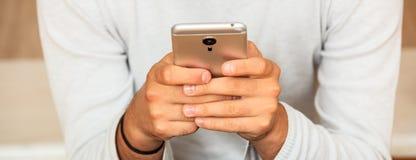 Man looking at his smart phone Royalty Free Stock Image