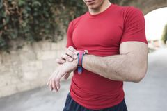 Young man looking his smart watch after training. Running for see his marks Royalty Free Stock Photo