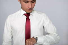 Young man looking at his wrist watch Stock Image
