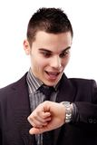 Young man looking at his wristwatch Royalty Free Stock Image