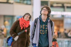 Young man looking at info screen Railway Station Utrecht, netherlands Royalty Free Stock Photography