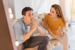 Young man looking irritated while his wife blaming him again Stock Photos