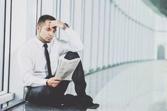 A young man is looking for a job. The guy looks at the job ads. Job wanted. Stock Photos