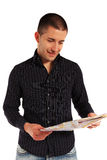 Young man looking at a map Royalty Free Stock Images