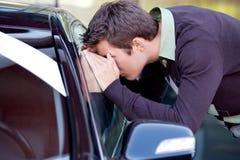 Young man looking at new car Royalty Free Stock Photo