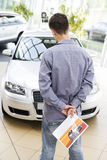 A young man looking at a new car Royalty Free Stock Images