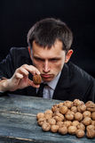 Young man looking at a nut Stock Images
