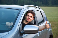 Young man looking out of car Royalty Free Stock Images