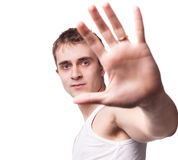 Young man looking out from under raised hand Royalty Free Stock Photography