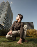 Young man looking over at a building Stock Photography