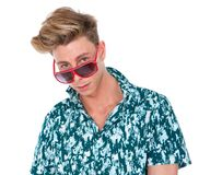 Young man looking over sunglasses Royalty Free Stock Photos