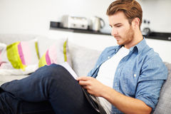 Young Man Looking Through Personal Finances At Home Stock Photos