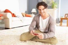 Young Man Looking At Photograph On Digital Camera Royalty Free Stock Photos