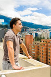 Young man looking at Quito city view from balcony Royalty Free Stock Images