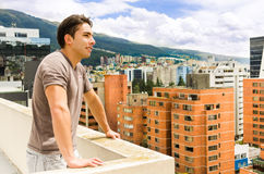 Young man looking at Quito city view from balcony Royalty Free Stock Photography