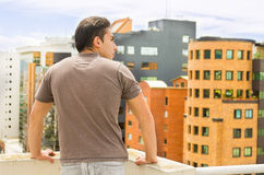 Young man looking at Quito city view from balcony Stock Images