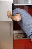 Young man looking in refrigerator Stock Photo