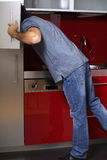 Young man looking in refrigerator Stock Image