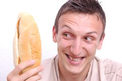Young man looking at sandwich Stock Images