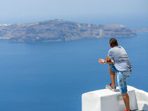 Young Man is looking on Santorini caldera Royalty Free Stock Photos