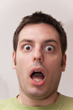Young man looking scared and shocked Stock Photography
