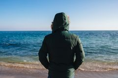 Back view of man looking at the sea. stock image