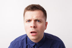 Young man looking shocked with his mouth opened Royalty Free Stock Images
