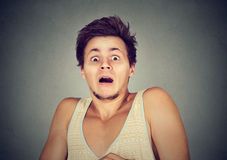 Young man looking shocked scared Royalty Free Stock Photography
