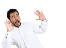 Young man looking shocked, scared trying to protect himself Stock Photos