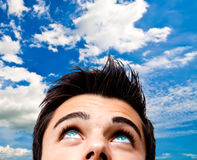 Young man looking at the sky Stock Image