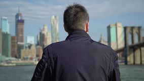 Young man looking at skyscrapers stock footage