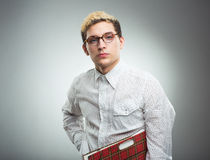 Young man looking to the camera wearing glasses Stock Images