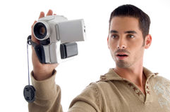 Young man looking in to video from handy cam Royalty Free Stock Image